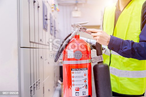Engineer inspection Fire extinguisher in control room.