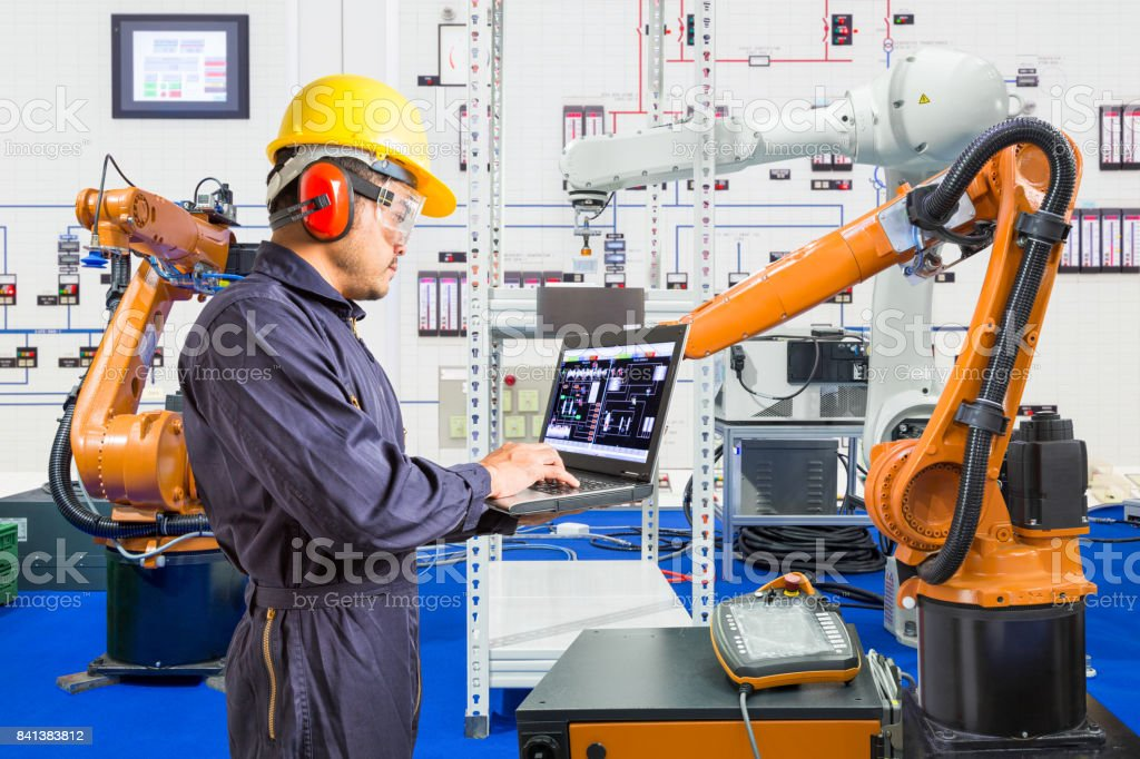 Engineer install and testing industry robotic in manufacturing of factory stock photo