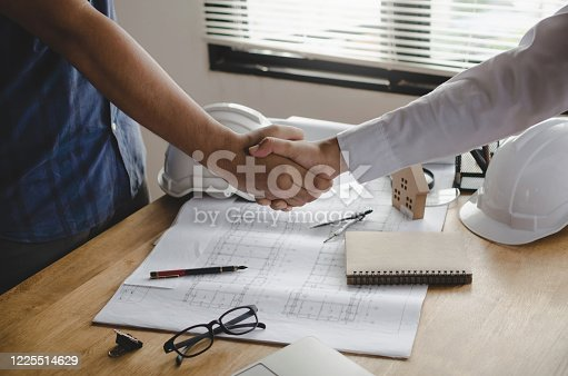 1055059750 istock photo engineer, interior designer and architect hands shaking greeting start up plan new project contract with blueprint on desk in meeting room office at construction site, partnership, contractor concept 1225514629