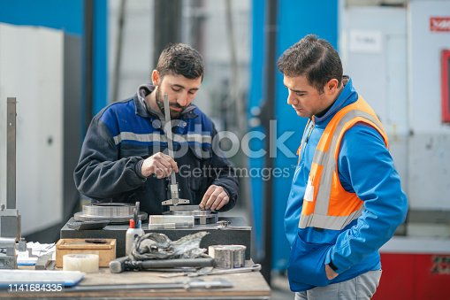 Engineer is checking worker