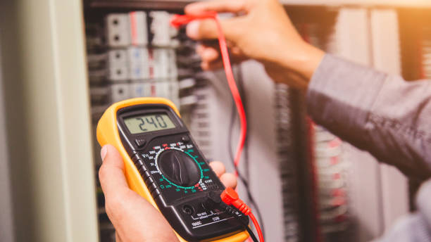 Engineer is measuring voltage or current by voltmeter in control panel Engineer is measuring voltage or current by voltmeter in control panel meter instrument of measurement stock pictures, royalty-free photos & images