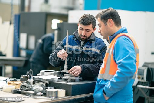 istock Engineer is visiting factory 1145637843