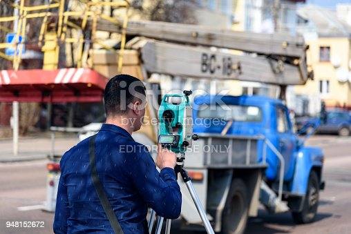 engineer land surveyor makes measurements on the street of the city of Chernigov, Ukraine, April 2018, editorial