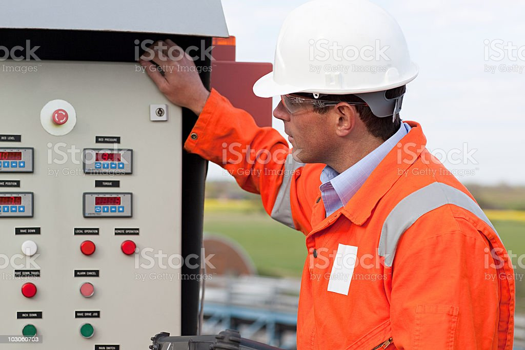 Engineer looking at control panel royalty-free stock photo