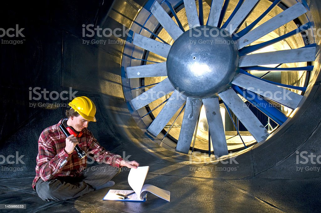Engineer looking at his notes stock photo