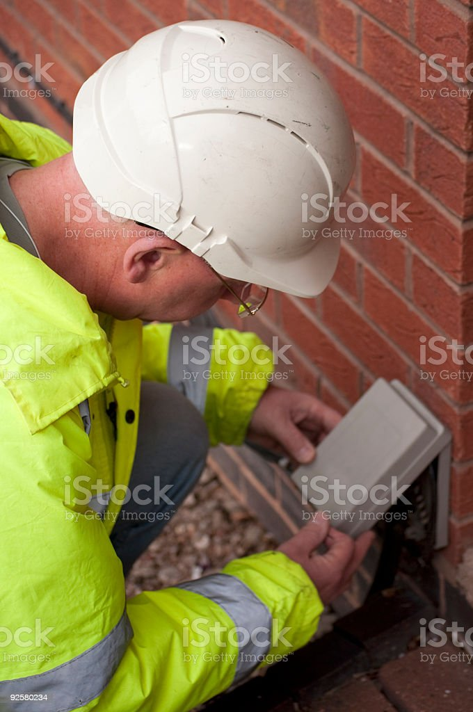 Engineer looks at electrical box. stock photo