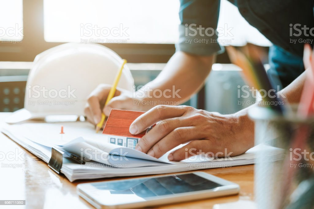 Engineer man working with drawings inspection in workplace in office. Engineering construction concept. architect and Business concept. stock photo