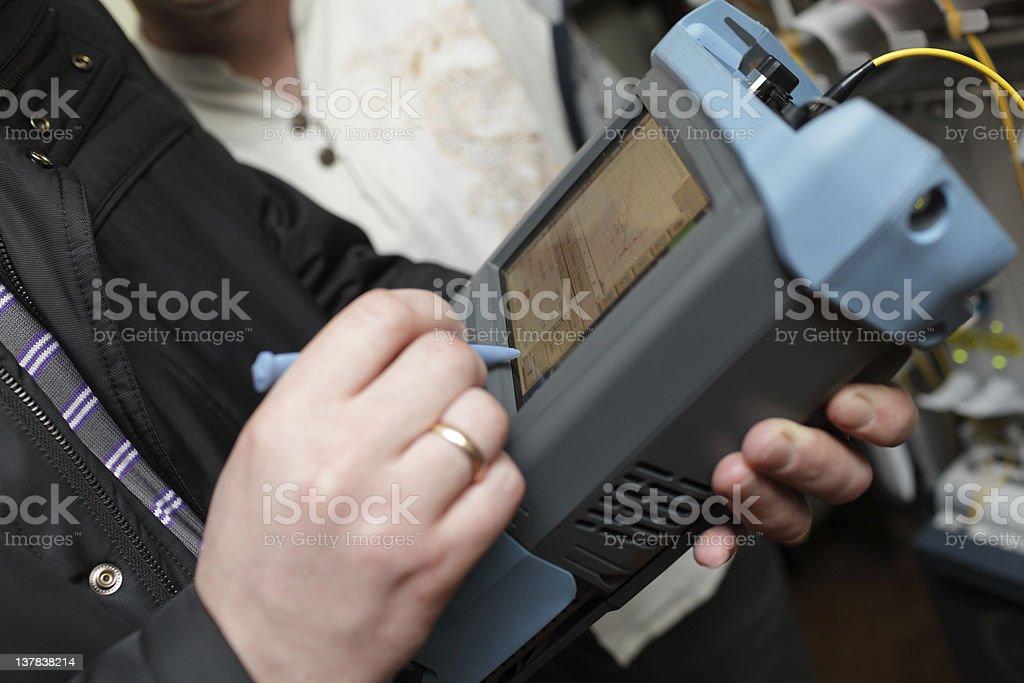 Engineer measuring fiber optic stock photo