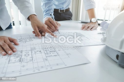 istock Engineer meeting for architectural project. working with partner 695448564
