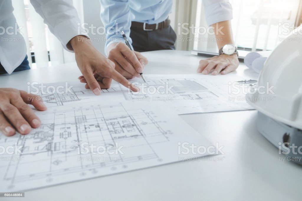 Engineer meeting for architectural project. working with partner - foto stock