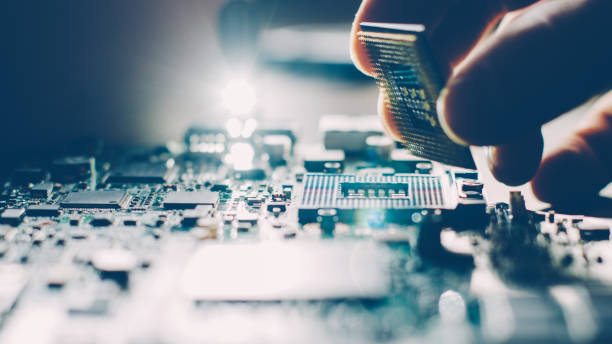 engineer motherboard computer technology repair Engineer plugging CPU microprocessor to motherboard socket. Computer technology and hardware maintenance or repair. circuit board stock pictures, royalty-free photos & images