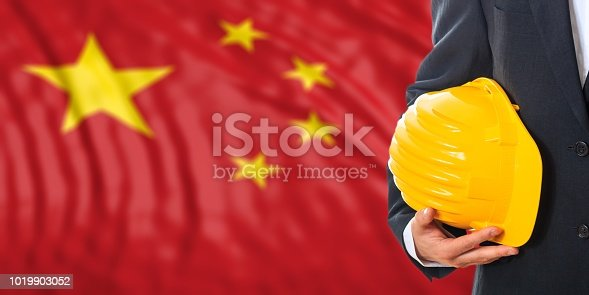 istock Engineer on a China flag background. 3d illustration 1019903052