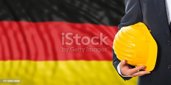 istock Engineer on a Germany flag background. 3d illustration 1019902692