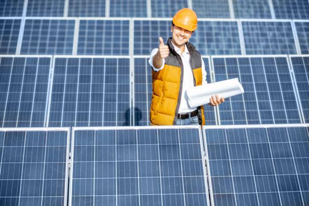 Engineer on a solar power plant stock photo
