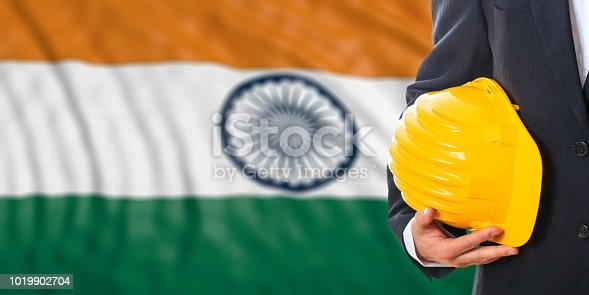 istock Engineer on an India flag background. 3d illustration 1019902704