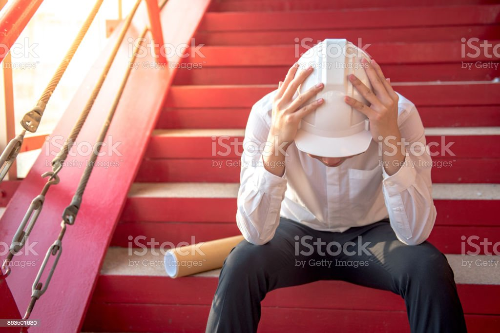 Engineer or Architect feeling tired and headache stock photo
