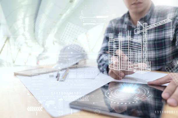 ingenieur oder architekt suchen und berühren schnittstelle mit dem gebäude design reality-virtuelle technologie auf computer-tablet in modernen büro vor ort. gebäudeautomatisierung digitales drahtloses steuerungskonzept - architekturberuf stock-fotos und bilder