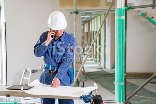 1054724700istockphoto Engineer or inspector at building construction site talking on smartphone 578288176