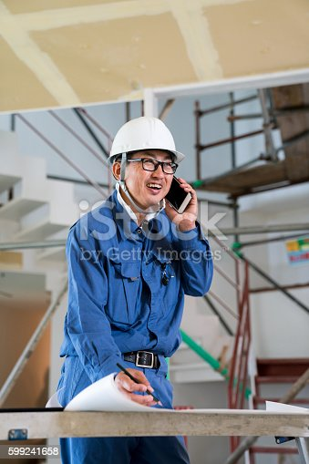 1054724700istockphoto Engineer or inspector at building construction site talking on smartphone 599241658