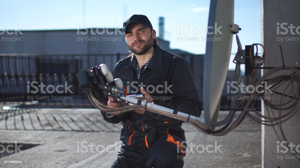 Engineer or technician checking an antennae with touchpad stock photo
