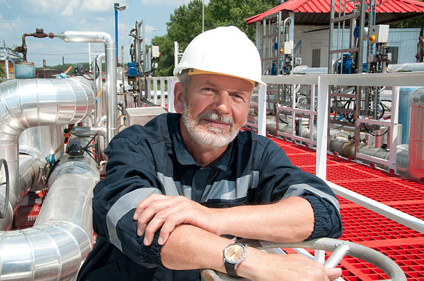 engineer overlooking oil pipeline stock photo