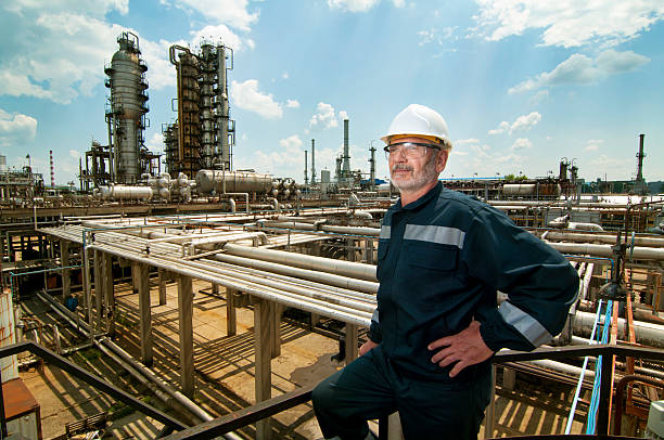 Engineer overseeing oil refinery stock photo