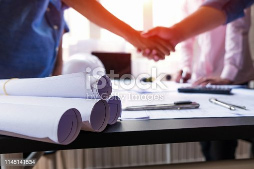 istock engineer people shaking hands in office, engineering concept, architecture concept, teamwork concept 1145141534