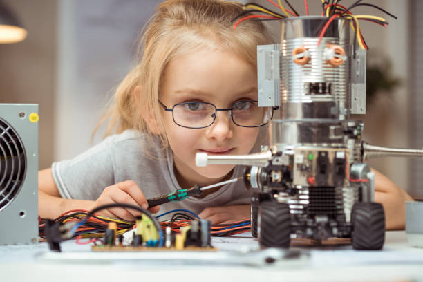 Engineer Little girl making robot child prodigy stock pictures, royalty-free photos & images