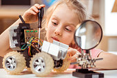 Little girl making electric car