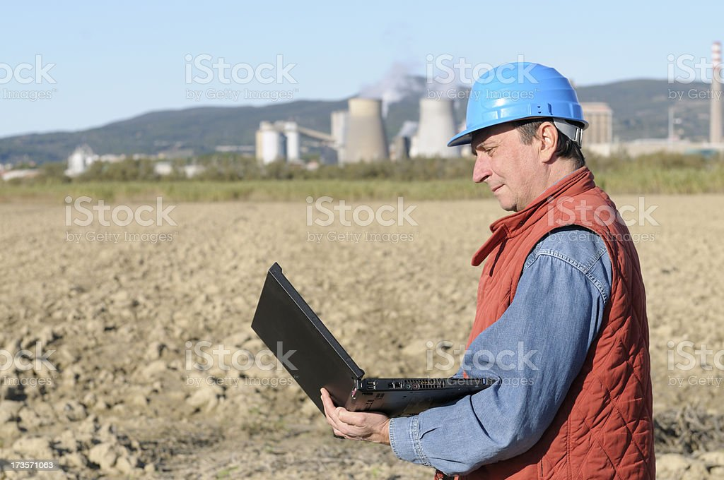 Engineer Planning PC and Oil Industry stock photo