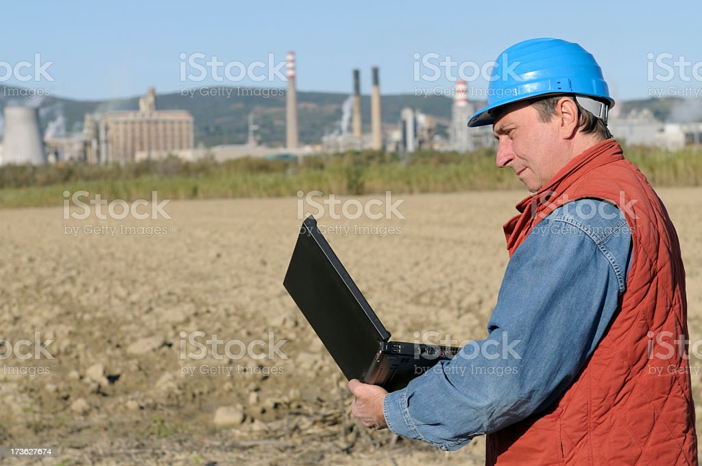 Engineer Planning PC and Oil Industry royalty-free stock photo