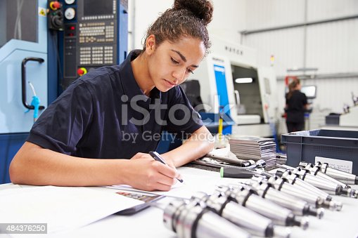 istock Engineer Planning Project With CNC Machinery In Background 484376250