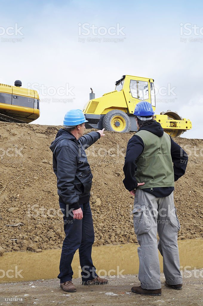 Engineer Pointing Earth Mover stock photo