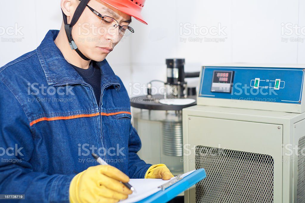 Engineer recording the experimental data royalty-free stock photo