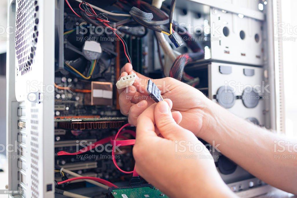 Engineer repairs computer's hard drive stock photo