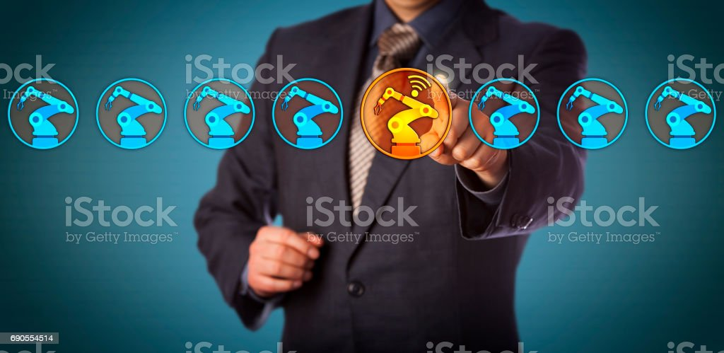 Engineer Selecting A Wireless Enabled Robotic Arm stock photo