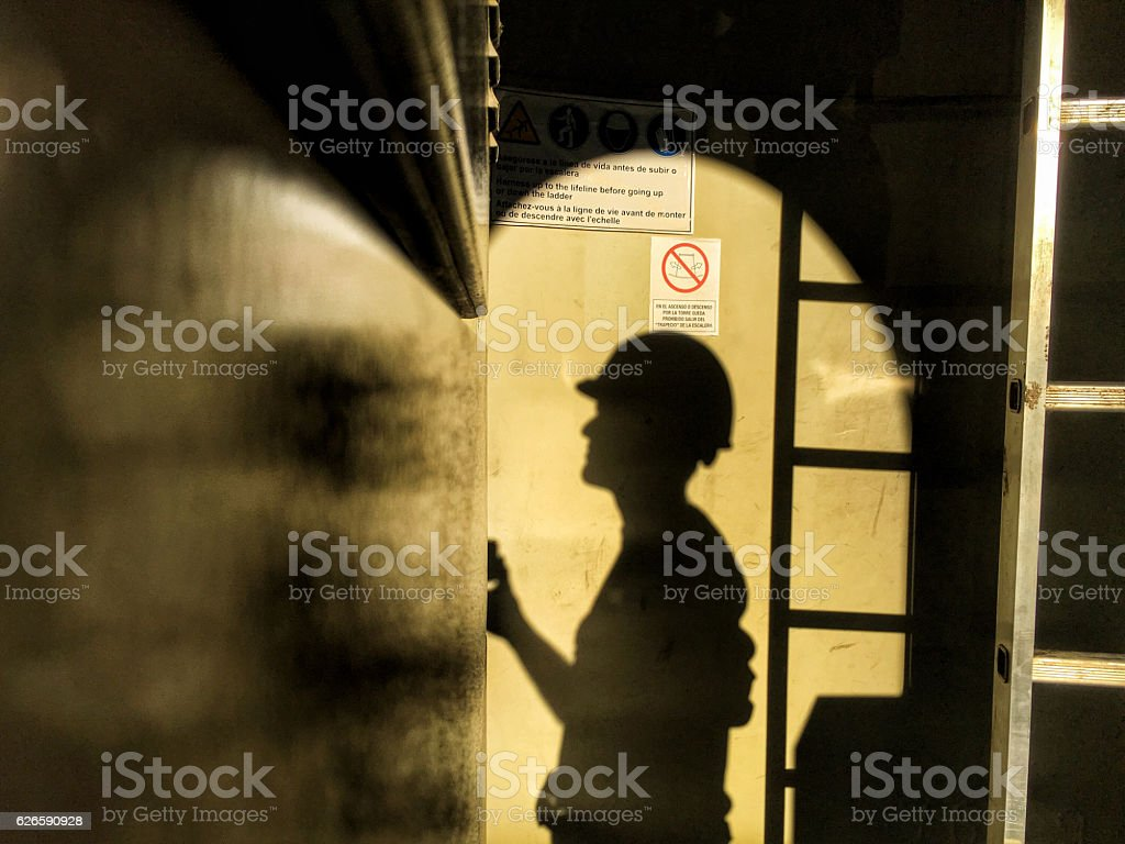 Engineer shadow working in a wind turbine. stock photo