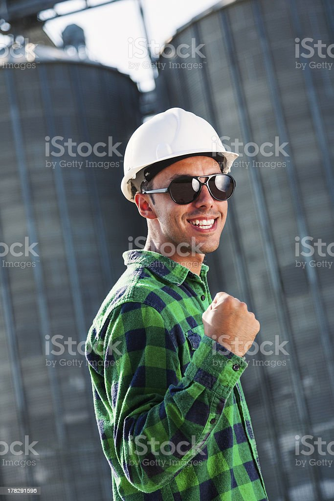 Engineer smiling and expressing positive energy royalty-free stock photo