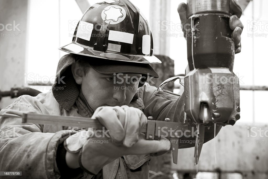 Engineer stares at drilling bit royalty-free stock photo