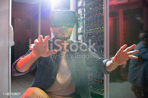 istock IT engineer studying server systems using VR goggles 1153742627