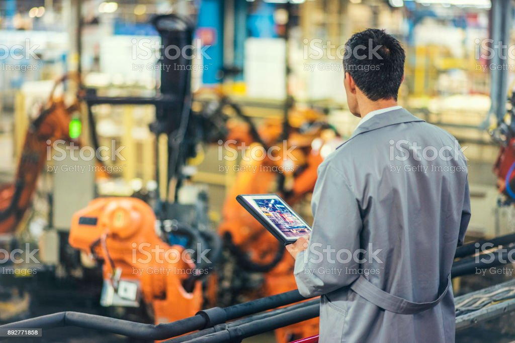Engineer supervising autonomous producton process stock photo
