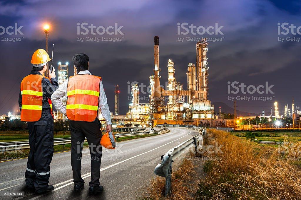 Engineer survey of oil refiner stock photo