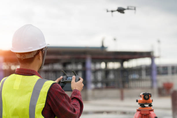 Engineer surveyor working with drone at construction site stock photo