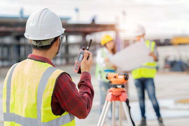Engineer surveyor working with theodolite at construction site stock photo