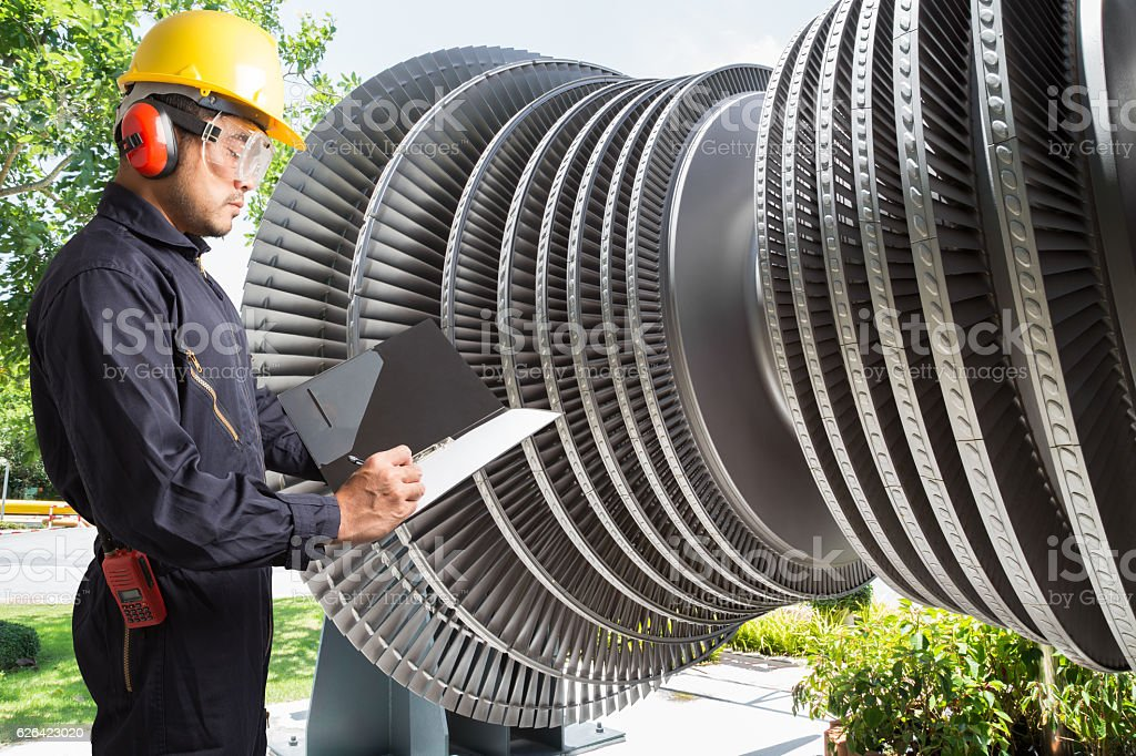 Engineer taking notes for maintenance steam turbine stock photo