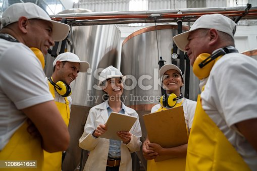 istock Engineer talking to a group of operators at a brewery 1206641652