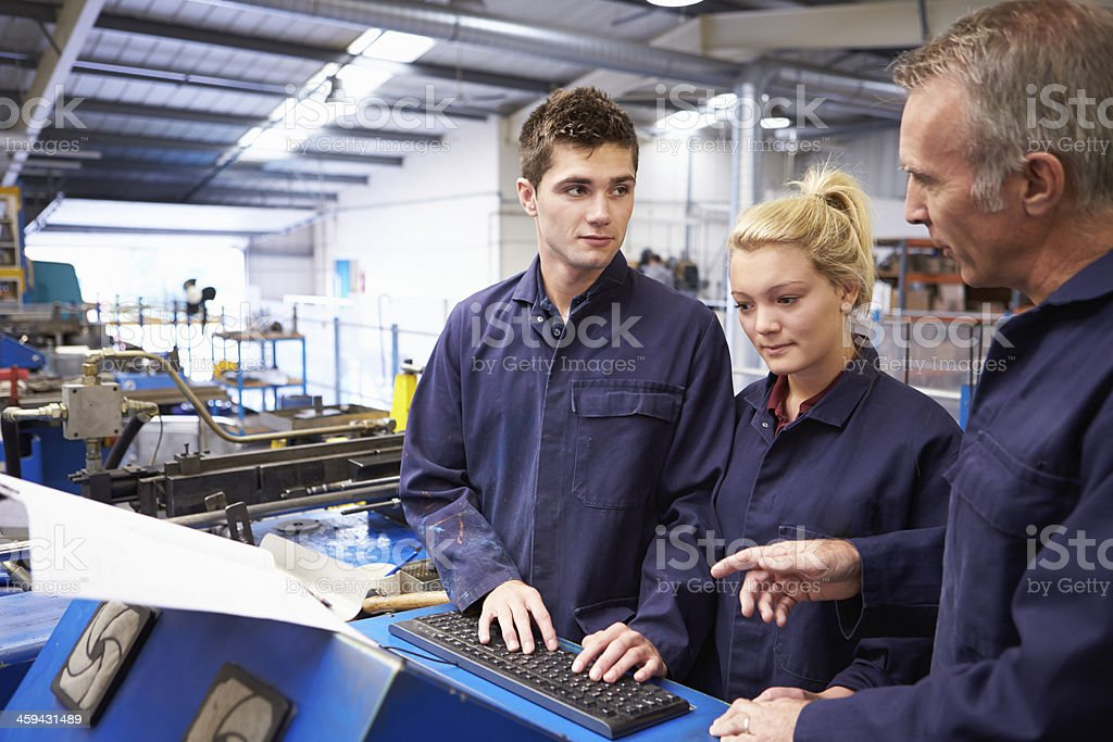 Engineer Teaching Apprentices To Use Tube Bending Machine stock photo