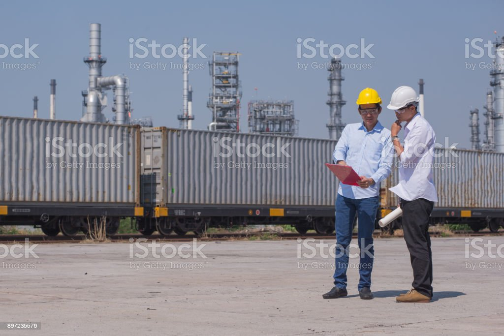 Engineer team consult and working in industry zone stock photo