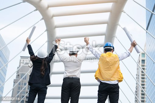 istock Engineer team hand up in front of the building, Engineering successful and teamwork concept 903383114