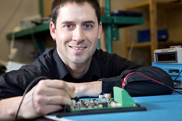 Engineer testing a circuit board assembly stock photo